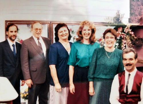 Six members of the Wilson family, posing in-store some time in the late 1980s